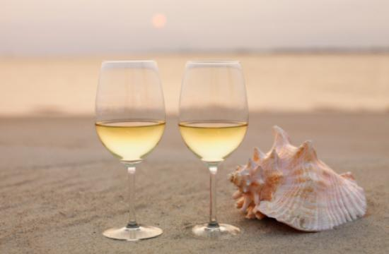 "Enjoy wine tastings at ""An Evening on the Beach"" to benefit St. Vincent Meals on Wheels on July 26."