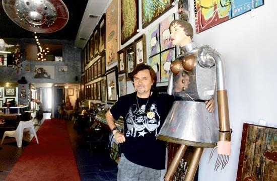 Gabor Csupo poses next to local artist Baron Margo's metal sculpture.