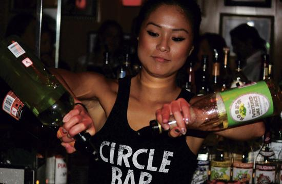 Bartender Mina Lee serves up a cocktail at Circle Bar.