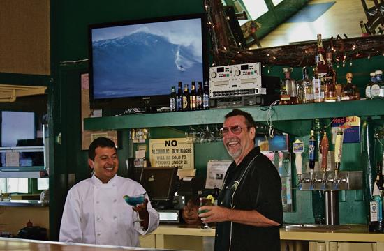 "Russell ""Rusty"" Barnard (right) with Chef Carlos will continue to serve up food and drinks at Rusty's Surf Ranch on the pier for another 10 years."