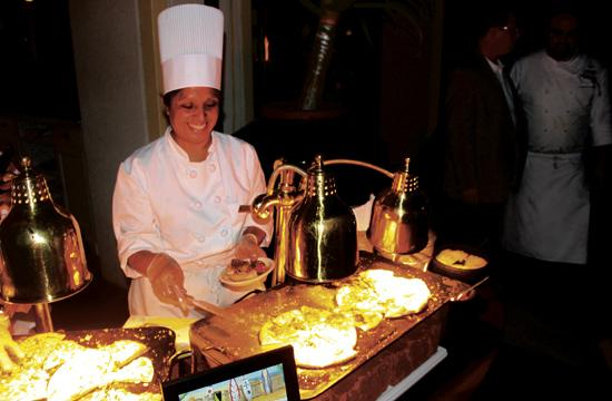 """Sonia Muralles created pizzas by the hotel's pool at last Friday's """"Live From Loews: California Classics"""" event"""
