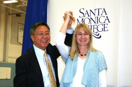 SMC President Dr. Chui L. Tsang celebrates the announcement that SMC chemistry professor Deborah H. Schwyter was awarded the SMC Foundation's Northrup Grumman/Marvin Elkin Chair of Excellence in Physical Sciences.