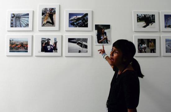 Twelve-year-old Diana Ramirez shows off some of her photos she snapped during this year's Kids With Cameras program.