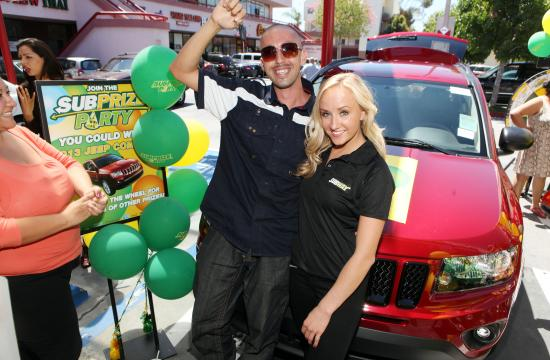 Santa Monica resident Ismael Munoz receives the keys to his new jeep from Subway Famous Fan Nastia Liukin.