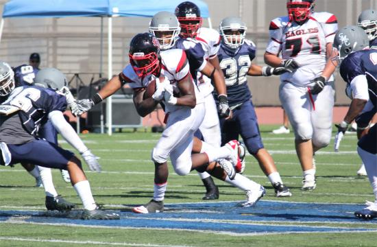 Eagles running back Superior Reed plows through the Corsair defense and picks up yardage during the fourth quarter.