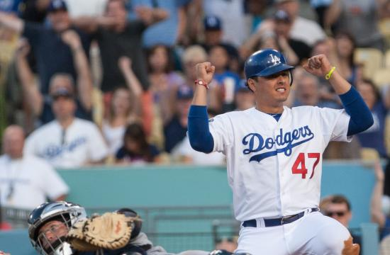 Dodger Luis Cruz celebrates after scoring in the fifth inning against the San Diego Padres at Dodger Stadium on Monday