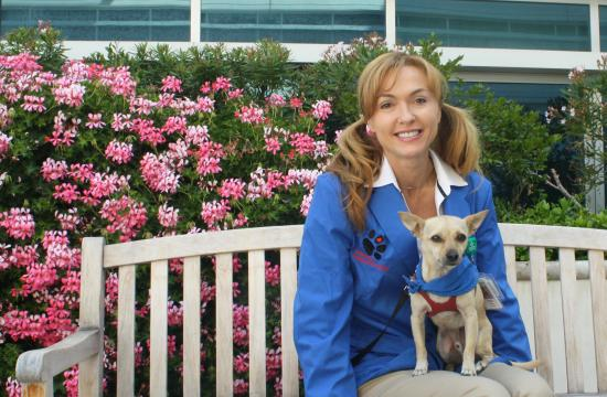Volunteer Natalie Gray poses with her dog Jack who is part of the Pawsitive Pet Program.