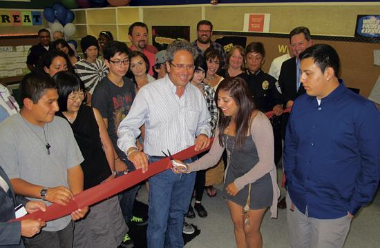 Ribbon cutting ceremony at the new branch. Pictured is Janie Gates (OHS Principal) to left of Mayor Bloom; Mayor Richard Bloom (center); Tish Murry