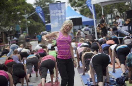 The free yoga event was held last year in Santa Monica on the Third Street Promenade. This year's celebration has moved to the Santa Monica Pier.