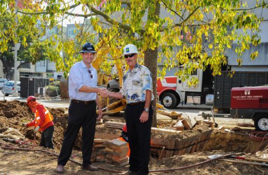 Alliance Residential Senior Development Director Jonas Bronk shaking hands with Santa Monica's Community Forester Walt Warriner.