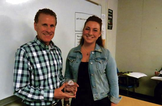 Santa Monica College sophomore Monique Kaminskaya presents professor Daniel Cooper with a Teacher Goody Award on Wednesday.
