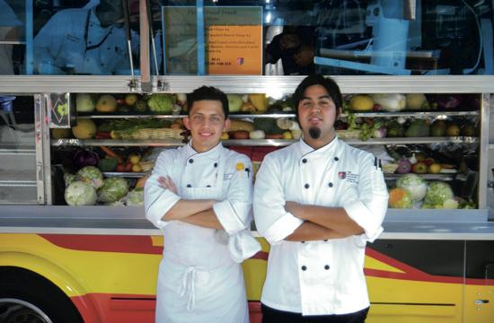 Winning student chefs Armando Garcia and Seiji Suenaga in front of the Art Institute's food truck after their victory on Saturday.