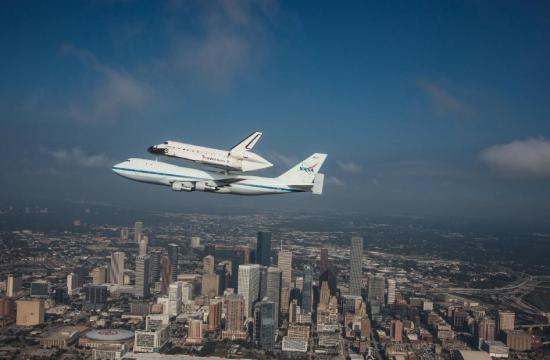 Space Shuttle Endeavour is ferried by NASA's Shuttle Carrier Aircraft (SCA) over Houston