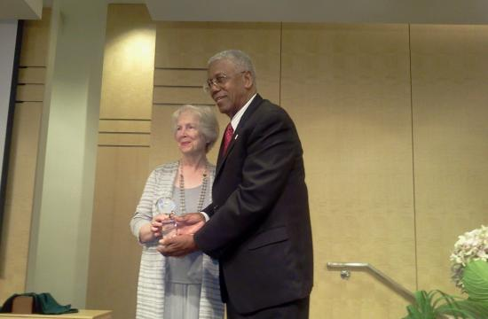 Nat Trives receiving the award from Chair of the Santa Monica Bahai Assembly Sheila Banani.