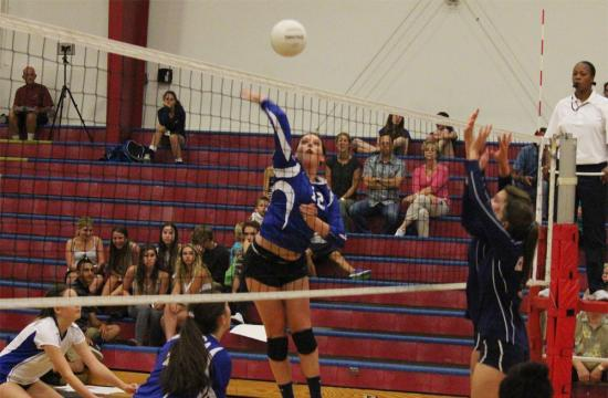 Grace Minchin of Pacifica Christian scores a point against Crossroads in the second set during their 3-0 win over the Roadrunners Friday Sept. 21.