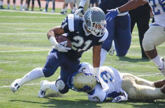Myles Johnson of Santa Monica College picks up 15 yards in the second quarter against the West Los Angeles College Wildcats during the Corsairs win 31-21.  Johnson would go on to rush for 112 yards on Sept. 22.