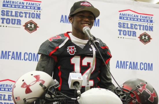 Sebastian LaRue smiles at an award ceremony presented by Under Armour at Santa Monica High School Monday night.  LaRue was chosen to participate in the upcoming All-America game to be held in Florida in January 2013 after his senior football season at Samohi.