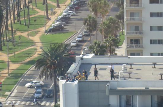 Santa Monica police apprehend a man on top of the Fairmont Miramar Hotel who was threatening to jump off the roof on Tuesday afternoon.