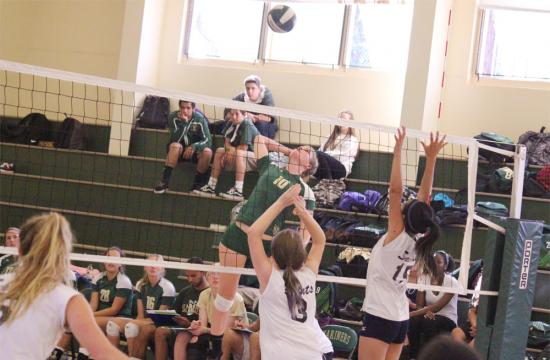 Dominique Booth of the St. Monica Mariners goes up for a kill in the third set against the Lighthouse Christian Saints at home Thursday.