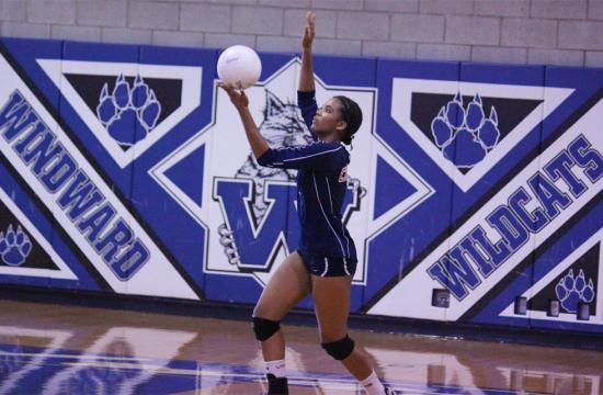 Cherokee Washington of the Crossroads Roadrunners serves the ball during the third set against the Windward Wildcats Thursday.