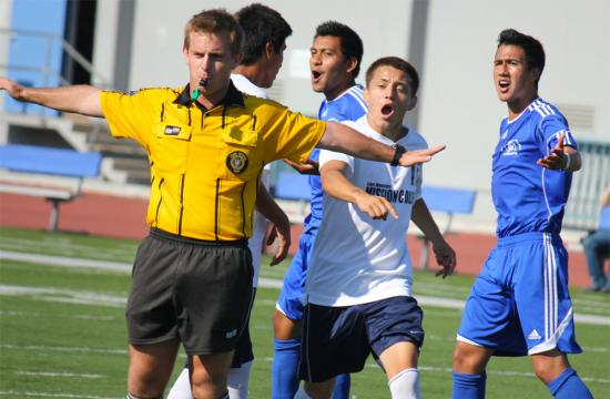 A referee nullifies what appeared to be a score by Ricardo Ocampo (center) of Santa Monica College at home Friday afternoon that would have put the Corsairs up 2-0 in the first half during their first loss of the season to Los Angeles Mission College 3-2.   Luis Fuentes (right) of the Corsairs also complains about the call.