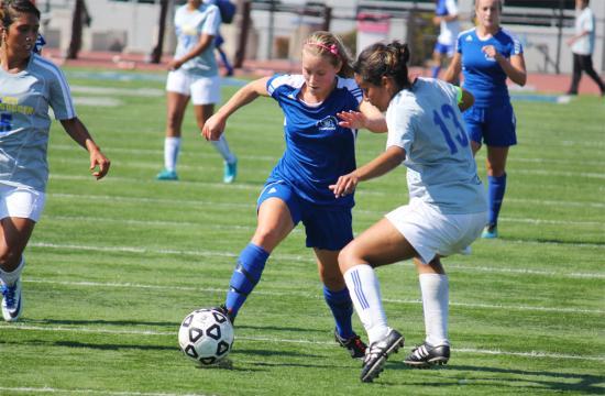 Forward Rosie Potts of Santa Monica College takes on Vanessa Gonzalez of the West Los Angeles Wildcats during the Corsairs victory 9-0 on the Corsair Field Tuesday afternoon. Potts scored two goals in the second half.