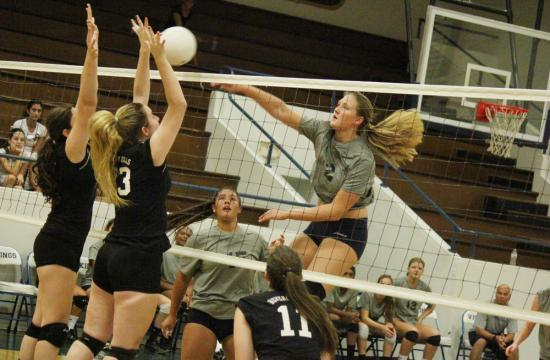 Joslyn Hayes of Santa Monica High School gets a kill against Beverly Hills High School to capture the lead for the Vikings at home against the Normans 18-17 during the first set Wednesday afternoon.