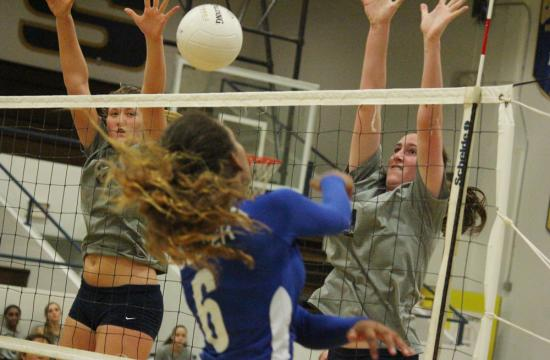 Santa Monica High School's Joslyn Hayes (left) and Jordan Levy (right) block Culver City Centaurs outside hitter Taylor Selfridge's attempted kill to put the Vikings up 11-6 in the first set home on Oct. 5.