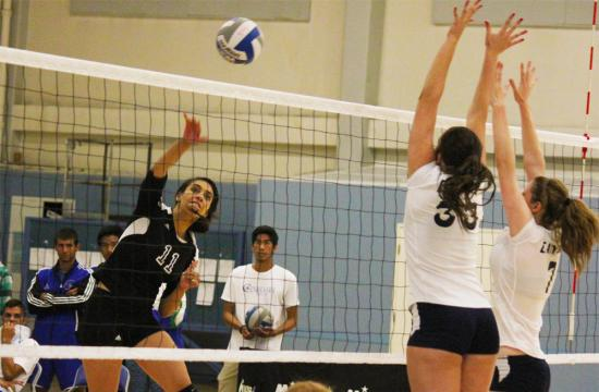 Outside hitter Jenae Jenkins of Santa Monica College attempts a kill against Canyons during the third set Friday night at home.