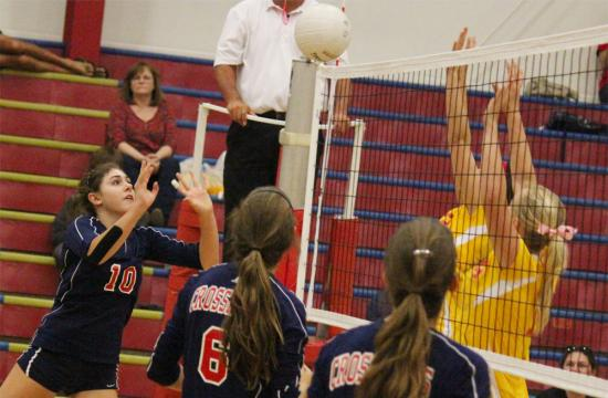 Olivia Leventhal of Crossroads pushes the ball over the net against the Paraclete Spirits during the third set Thursday at home to bring the Roadrunners within two points at 13-11.