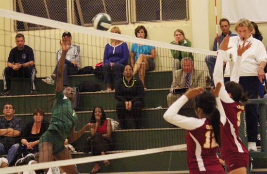 St. Monica's Briana Nixon gets a kill during the second set to up the Mariners score to 14-13 against the Cardinals at home Tuesday night.
