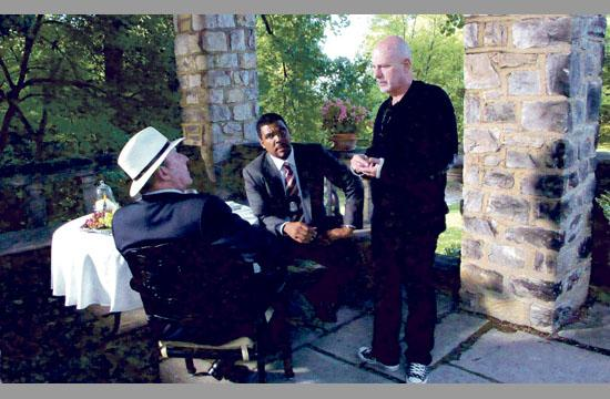 French Actor Jean Reno (from left) and Tyler Perry discuss a scene with director Rob Cohen.