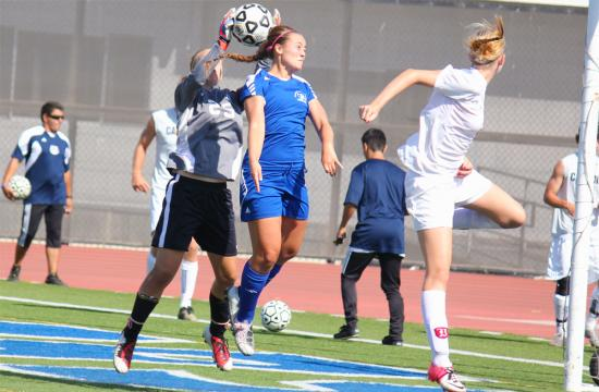 Santa Monica College's Briana Mackey attempts a header against Bakersfield's Erin Griepsma at home Tuesday afternoon.