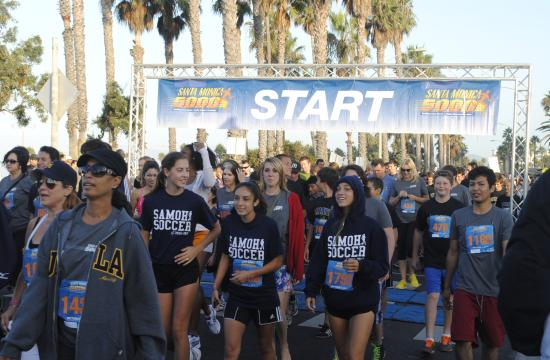 Participants begin the Santa Monica 5000 on Ocean Avenue last Sunday