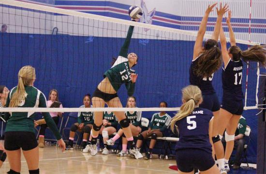 Outside hitter Kirsten Avila of Archer goes up for a kill against the Notre Dame defense during set one.  Archer upset the top ranked Division 4-A school 2-1 on Friday afternoon.