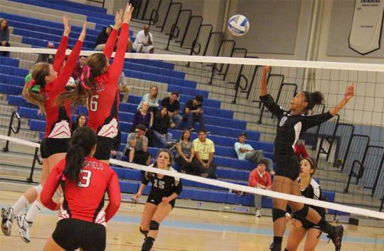 Santa Monica College middle blocker Justyce Smith gets the volley going for the Corsairs leading a comeback against Bakersfield during the third set at home Friday night.