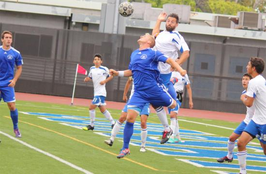 Santa Monica College defender Ricky Malmstroem keeps the ball away from the Corsairs goal with a header in the first half against Allan Hancock College at home Friday afternoon.