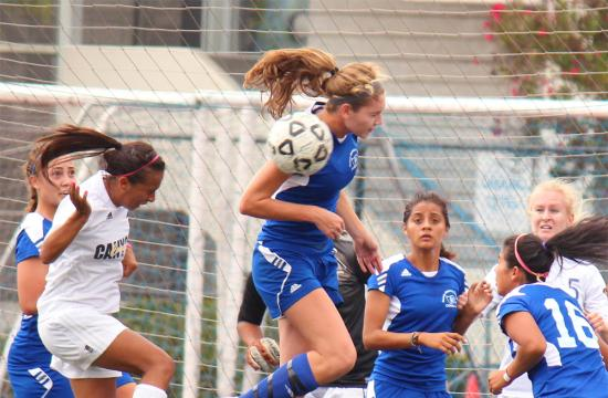Santa Monica College defender Carrie Markwith (center) leads the defense for the Corsairs in stopping the vaunted offensive attack of Canyons with a header at home Friday afternoon.