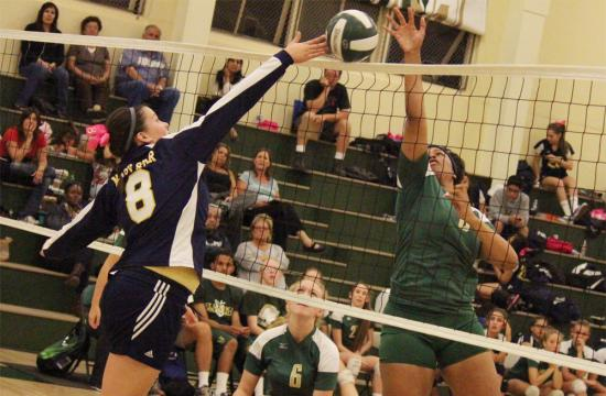 St. Monica's Chanel Smith battles the Stars Caroline Cosgrove for a point during the second set that tipped the game 19-16 in favor of the Mariners against Mary Star of the Sea High School at home Tuesday evening.