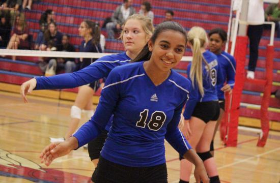 Windward's Mycayla Smith celebrates with the rest of the Wildcats after she made a kill during league play against Crossroads on Oct. 23.