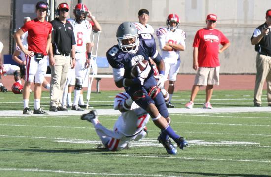 Santa Monica College wide receiver Reggie Mitchell makes a catch against Santa Barbara College at home Saturday