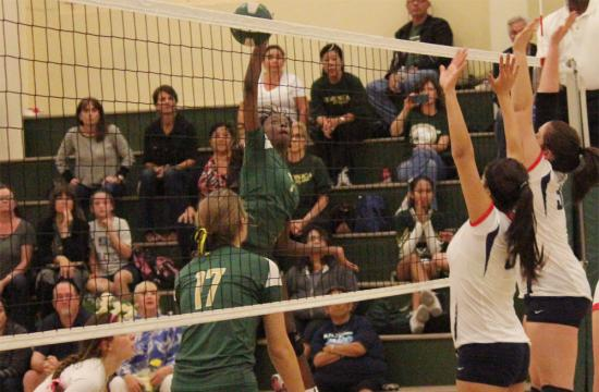 Opposite hitter Briana Nixon makes a kill for St. Monica against St. Paul to put the Mariners within six at 22-16 during the third set at home Monday night.