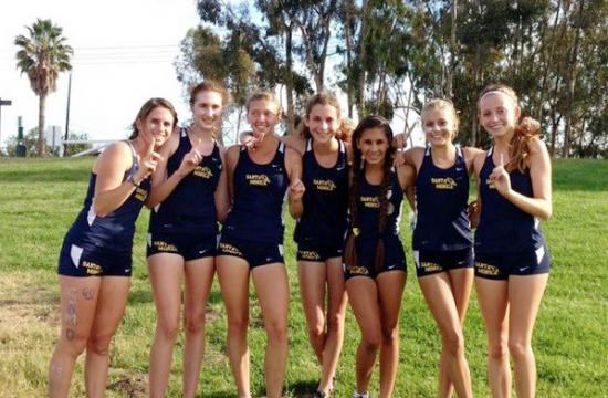 The Santa Monica High School Girls Cross Country team poses after beating Beverly Hills to claim the league finals.