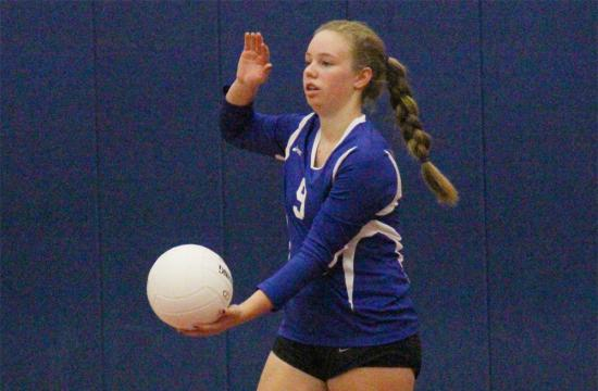 Freshman outside hitter Maddie Reasner serves the ball during the second set against the Duarte Falcons at Crossroads High School Tuesday night.
