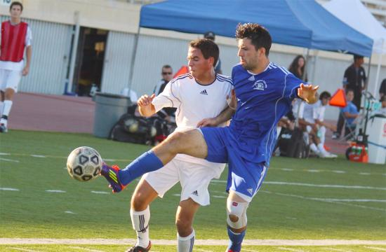 Santa Monica College forward Alesandro Canale fights for the ball against Nikilaus Rader of the Fighting Owls in a soccer match against the Citrus College at home Tuesday afternoon.