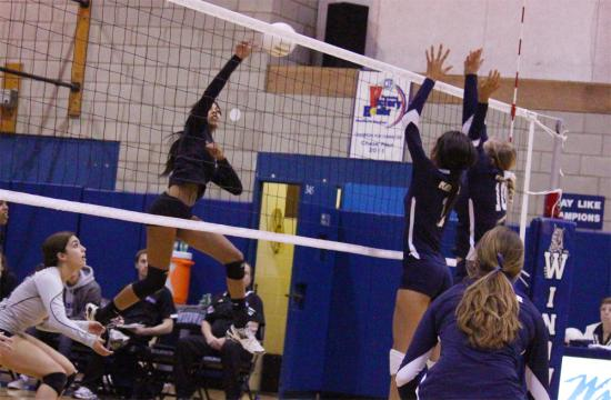 Windward's outside hitter Christina Cornelius makes a kill during the first set to put the Wildcats up 1-0 over the Monsoons Saturday night at the Jackson Center.