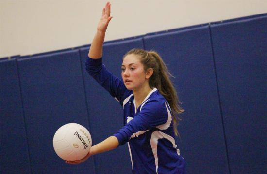 Pacifica Christian's Kiani Lane sets a ball during a match against Beverly Hills at the Brentwood Volleyball Tournament on Oct. 12