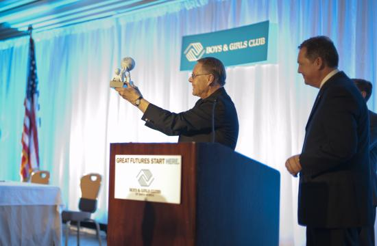 The Boys and Girls Clubs of Santa Monica honored Monsignor Lloyd Torgerson (left) at its biggest annual fundraiser on Nov. 2. He is pictured accepting the award from Bill Dawson