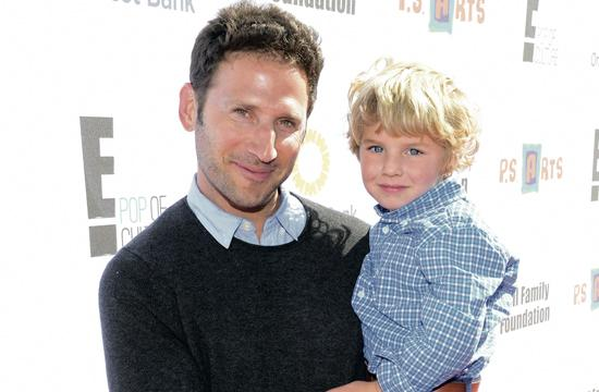"""Actor Mark Feuerstein attends the creative arts fair and family day """"Express Yourself"""" with his son"""