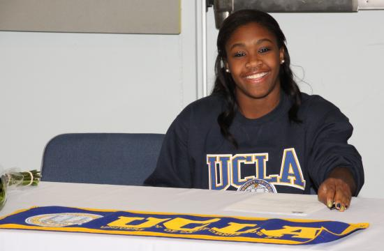 Hallie Mossett signs her Letter of Intent to join the Division I university athletic program at UCLA.